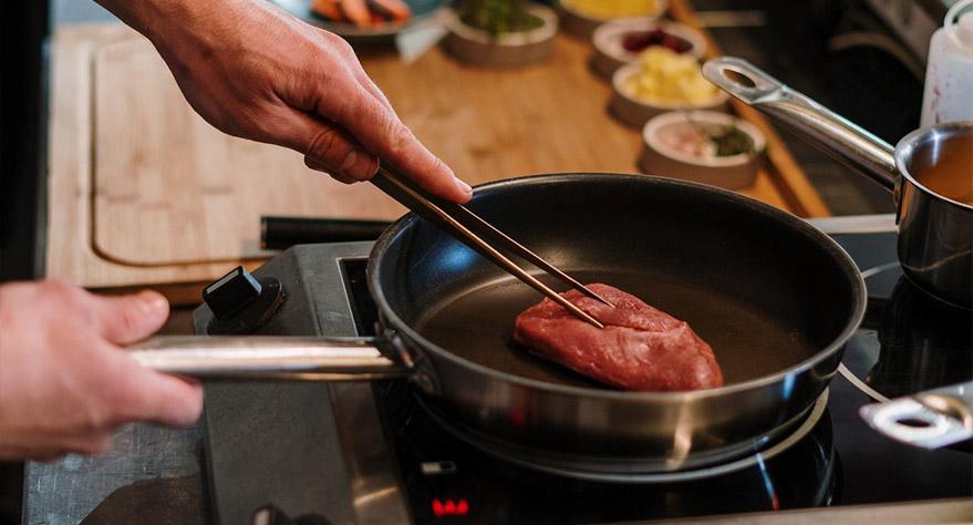 a que temperatura cocinar carne en horno electrico